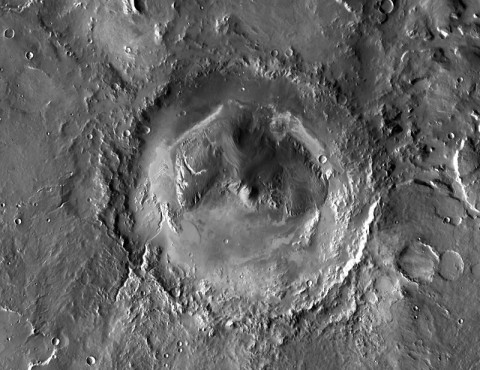Gale crater photographed from above by NASA's Mars Odyssey orbiter. Within Gale, an impressive layered mountain rises about 5 kilometers (3 miles) above the crater floor. (Credit: NASA, JPL-Caltech, ASU)