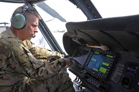 Chief Warrant Officer 4 Joel Sizelove, the production control officer in charge for Task Force Lift, checks the readouts from the integrated vehicle health management system on a UH-60M Black Hawk to determine, among other things, track vibrations in the rotors. IVHMS ultimately saves maintainers hours or even days of work and gets the aircraft and its crew back into the fight faster. (Photo by Jennifer Andersson, 159th Combat Aviation Brigade Public Affairs)