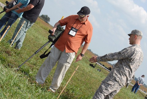The president of Barreto group, Inc., Rodney Barreto tries out a mine detector while being advised by Capt. Robert St. Claire, an instructor for the Joint Civilian Orientation Conference during their visit to Fort. Campbell, September 22nd. Participants of the JCOC visited the base to gain insight on what the Army does on a routine basis. (Photo by Sgt. Scott Davis)