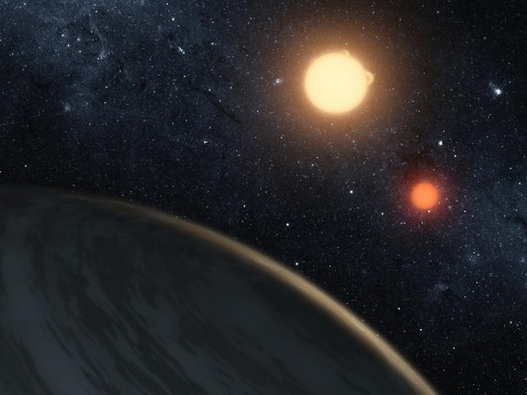 An artist's concept of Kepler-16b, the first planet known to definitively orbit two stars -- what's called a circumbinary planet. The planet, which can be seen in the foreground, was discovered by NASA's Kepler mission. (Credit: NASA/JPL-Caltech/T. Pyle)