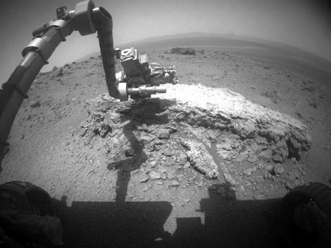 "NASA's Mars Exploration Rover Opportunity used its front hazard-avoidance camera to take this picture showing the rover's arm extended toward a light-toned rock, ""Tisdale 2,"" during the 2,695th Martian day, or sol, of the rover's work on Mars (August 23rd, 2011). (Photo by NASA/JPL-Caltech)"