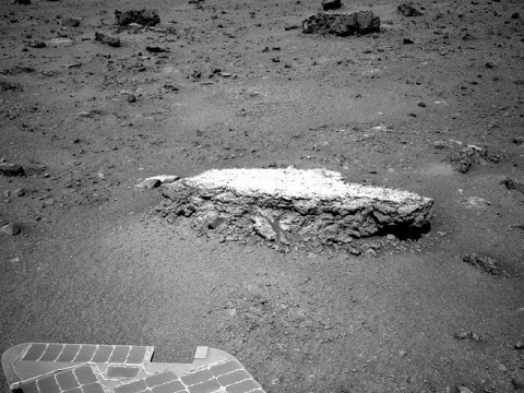 "NASA's Mars Exploration Rover Opportunity used its navigation camera to take this picture showing a light-toned rock, ""Tisdale 2,"" during the 2,690th Martian day, or sol, of the rover's work on Mars (August 18th, 2011). (Photo by NASA/JPL-Caltech)"