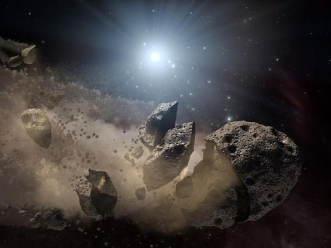 Scientists think that a giant asteroid, which broke up long ago in the main asteroid belt between Mars and Jupiter, eventually made its way to Earth and led to the extinction of the dinosaurs. Data from NASA's WISE mission likely rules out the leading suspect, a member of a family of asteroids called Baptistina, so the search for the origins of the dinosaur-killing asteroid goes on. This artist's concept shows a broken-up asteroid. (Image credit: NASA/JPL-Caltech)