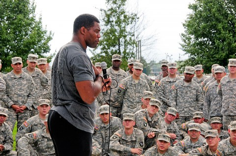 Herschel Walker, former NFL player and mixed martial arts fighter, speaks to Soldiers of 1st Battalion, 320th Field Artillery Regiment, 2nd Brigade Combat Team, 101st Airborne Division (Air Assault), at the Top Guns battalion's headquarters at Fort Campbell, KY, Sept. 28th. Walker shared his personal struggle through mental health care problems, his rebound and recovery and encouraged Soldiers to seek help whenever it is needed. (U.S. Army Photo By Spc. Shawn Denham, PAO, 2nd BCT, 101st Abn. Div.)