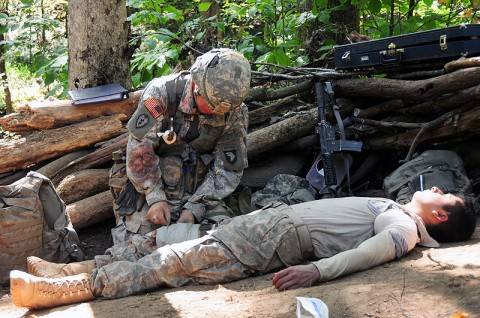 Sgt. Matthew Baumann, with Headquarters and Headquarters Company, 1st Battalion, 502nd Infantry Regiment, 2nd Brigade Combat Team, 101st Airborne Division (Air Assault), treats a simulated casualty during testing for the Expert Field Medical Badge at Fort Campbell, October 5th. Baumann and 11 other Soldiers from Strike Brigade received their EFMB's the next day. (U.S. Army Photo By Spc. Shawn Denham, PAO, 2nd BCT, 101st Abn. Div.)