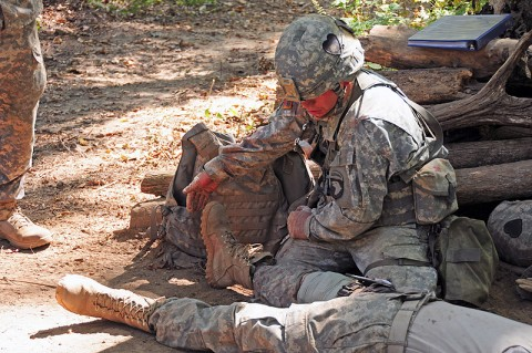 Sgt. Matthew Baumann, with Headquarters and Headquarters Company, 1st Battalion, 502nd Infantry Regiment, 2nd Brigade Combat Team, 101st Airborne Division (Air Assault), tests a the responses of a simulated casualty during testing for the Expert Field Medical Badge at Fort Campbell, KY, October 5th. Medics throughout the division competed together to earn the prestigious badge which represents their abilities and knowledge in combat medical care. (U.S. Army Photo By Spc. Shawn Denham, PAO, 2nd BCT, 101st Abn. Div.)