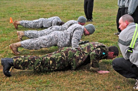 Staff officers with Headquarters and Headquarters Company, 2nd Brigade Special Troops Battalion, 2nd Brigade Combat Team, 101st Airborne Division (Air Assault), do pushups during the first part of the Iron Strike Challenge at Fort Campbell, KY, Oct. 20th. The competition puts teams from each battalion within the brigade together to see who can win based on finishing the course in the shortest amount of time. (U.S. Army Photo By Spc. Shawn Denham, PAO, 2nd BCT, 101st Abn. Div.)