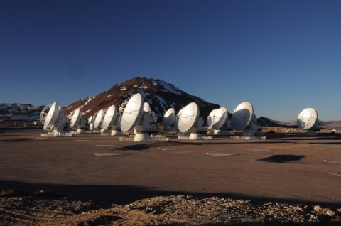 The Atacama Large Millimeter/submillimeter Array at its 16,500 ft elevation site in northern Chile. Still under construction, ALMA is the most powerful telescope of its kind in the world. At the time of this photo, 19 radio telescopes were in the array. Upon completion in 2013, 66 radio telescopes will fan over a nearly 100 square mile area. (W. Garnier, ALMA (ESO/NAOJ/NRAO))