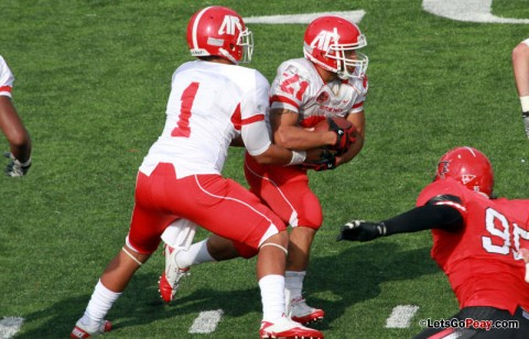 Freshman quarterback Landon Curtis hands off to Ryan White during last Saturday's game. APSU Football. (Courtesy: Austin Peay Sports Information)