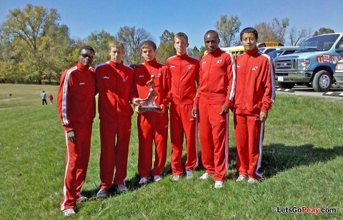 Austin Peay men's cross country team gathers around the championship trophy following its win at Kentucky Wesleyan, Saturday. APSU Cross Country. (Courtesy: Austin Peay Sports Information)