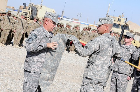 Command Sgt. Maj. John Seelhorst, command sergeant major of the 129th Combat Sustainment Support Battalion, and Lt. Col. Daniel Rickleff, the commander of the 129th, case their battalion colors as a transfer of authority ceremony at Camp Leatherneck, Helmand province, October 12th. The battalion staff was deployed to Regional Command Southwest, where they took over command and control of companies from active and reserves and Alaska to Germany. (Photo by Spc. Michael Vanpool)