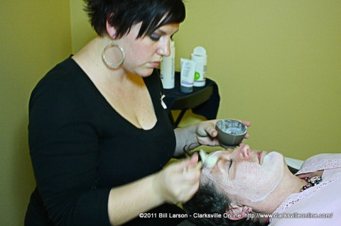 Miller-Motte Technical College Student Lauren Salnaker gives Breast Cancer Survivor Pat Karren a mini-facial