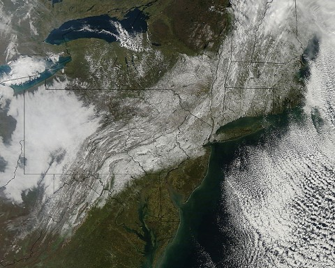 This visible image from the MODIS instrument on NASA's Aqua satellite on October 30th, 2011 at 11:30am EDT shows the extent of snowfall from the Halloween weekend Nor'easter that spread snow from West Virginia to Maine along the U.S. East coast. The snow is seen blanketing the ground, while clouds remain off-shore over the Atlantic Ocean. (Credit: NASA Goddard MODIS Rapid Response Team)