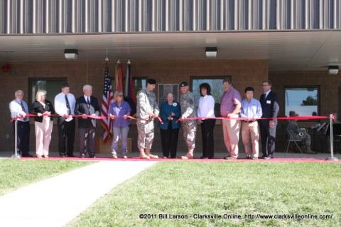 Rita Nicholson, the daughter of Col. Robert E. Jones cuts the ribbon to the new facility with Col. William B. Hickman the Deputy Commander of Operations for the 101st Airborne Division