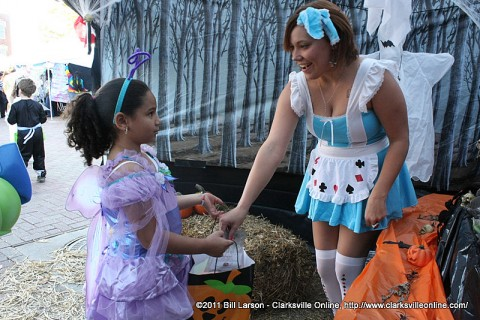 A young girl receives candy at Fright on Franklin