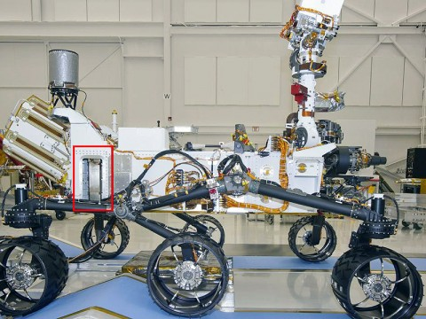 A Russian-built, neutron-shooting instrument on the Curiosity rover of NASA's Mars Science Laboratory mission will check for water-bearing minerals in the ground beneath the rover. (Image Credit: NASA/JPL-Caltech)