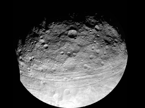 This full view of the giant asteroid Vesta was taken by NASA's Dawn spacecraft, as part of a rotation characterization sequence on July 24th, 2011, at a distance of 3,200 miles (5,200 kilometers). A rotation characterization sequence helps the scientists and engineers by giving an initial overview of the character of the surface as Vesta rotated underneath the spacecraft. (Image credit: NASA/JPL-Caltech/UCLA/MPS/DLR/IDA)