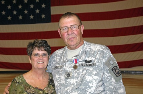Command Sgt. Maj. Dennis Creecy and wife, Janice, following retirement ceremonies at National Guard Headquarters in Nashville after his almost 42 years in the military. He wears the Tennessee National Guard Distinguished Service Medal he was awarded at the ceremony.