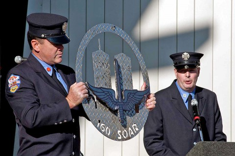 New York City Fire Department personnel Patrick Neville (left) and Justin Devine (right) present Regiment with a plaque recognizing Night Stalker contributions over a decade of deployments supporting the War on Terror during the unit's 30th Anniversary Celebration October 15th, 2011. Neville crafted the plaque using a piece of steel recovered from one of the World Trade Center towers and metal from a fire truck at ground zero to the Regiment. (160th Special Operations Aviation Regiment photo)