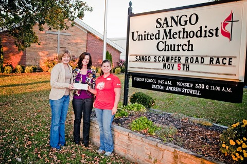 Habitat for Humanity of Montgomery County, TN accepts a donation from the Sango United Methodist Church (UMC).