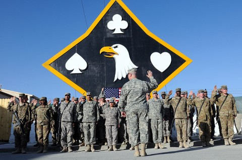 Col. Michael Peterman, the commander of the 101st Sustainment Brigade, re-enlists 31 of his soldiers in front of the brigade headquarters, October 2nd. Nearly 20 more Lifeliners re-enlisted at forward operating bases in Afghanistan and Iraq. (Photo by Spc. Michael Vanpool)