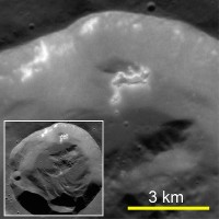 A fresh 15-km-diameter impact crater. Hollows are present on a section of the crater wall that has slid partway down toward the floor. (Courtesy of Science/AAAS)