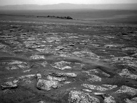 This image from the navigation camera on NASA's Mars Exploration Rover Opportunity shows the view ahead on the day before the rover reached the rim of Endeavour crater. It was taken during the 2,680th Martian day, or sol, of the rover's work on Mars. (Image Credit: NASA/JPL-Caltech)