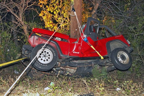 Jeep Wrangler goes over an embankment on the 41A Bypass and crashes into a utility pole sending four teenagers to the hospital. (Photo by CPD-Jim Knoll)