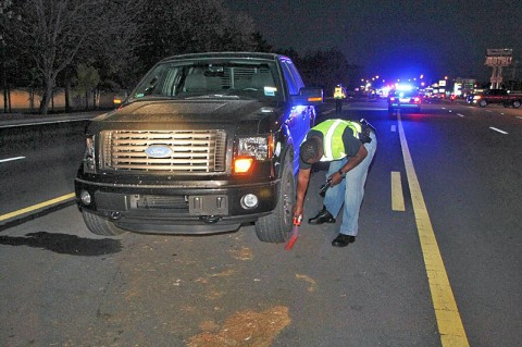 Officer Evon Parkes is marking the vehicle's location. (Photo by Jim Knoll-CPD)