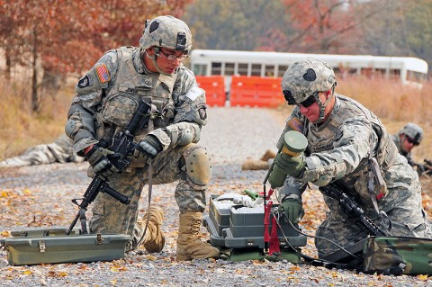 Pfc. Michael Jones and Pfc. Alexander Kornelakis, combat engineers with Company A, 2nd Brigade Special Troops Battalion, 2nd Brigade Combat Team, 101st Airborne Division (Air Assault), set up an anti-personnel obstacle breaching system during 'Sapper Stakes' at Fort Campbell, KY, Oct. 26th. Called 'APOBS', the system launches a line of explosive devices to trigger nearby hidden bombs to detonate. (U.S. Army Photo By Spc. Shawn Denham, PAO, 2nd BCT, 101st Abn. Div.)