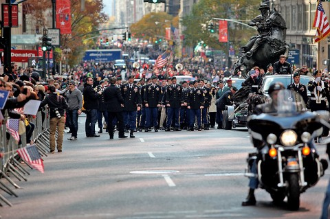 Green Berets from the 5th Special Forces Group (Airborne) walk alongside the newly dedicated De Oppresso Liber statue as it made its way down 5th Avenue as part of the New York City Veterans Day Parade, Nov. 11th, 2011. (Photo courtesy of Spec. Kerry Otjen)