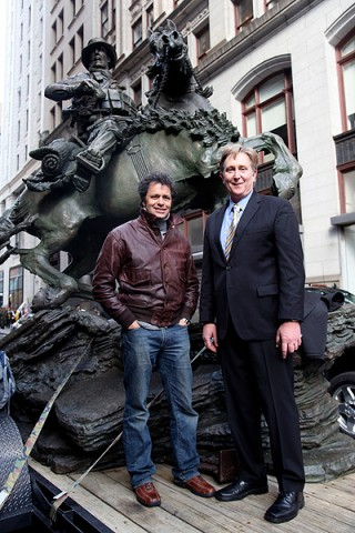Douwe Blumberg, the artist and sculptor of the De Oppresso Liber statue, and Mr. Doug Stanton, author of the book Horse Soldiers, stand in front of the 18-foot bronze statue prior to the start of the New York City Veterans Day Parade, Nov. 11th, 2011. (Photo courtesy of Spec. Kerry Otjen)