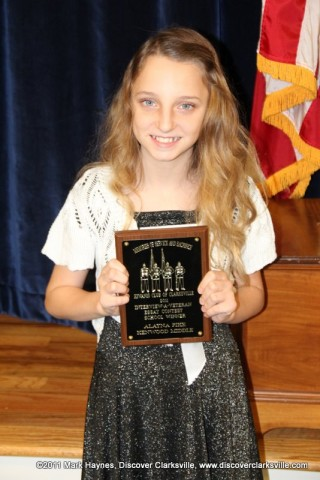 "Alayna Pike receives an award at the Clarksville Kiwanis Club's Memories of Service and Sacrifice Project's ""Interview a Veteran"" essay contest."