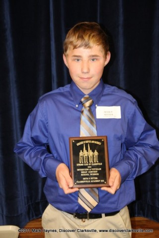 """Seth P. Sitter receives an award at the Clarksville Kiwanis Club's Memories of Service and Sacrifice Project's """"Interview a Veteran"""" essay contest."""