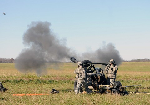 Section 2, Battery A, 2nd Battalion, 320th Field Artillery, 1st Brigade Combat Team, fires a 105 mm high explosive round from their M119 Howitzer Nov. 17th during their battery air assault raid here. (Photo by Sgt. Jon Heinrich)