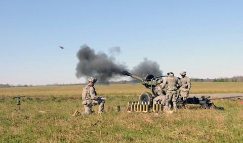Section 1, Battery A, 2nd Battalion, 320th Field Artillery, 1st Brigade Combat Team, fires a 105 mm high explosive round from their M119 Howitzer Nov. 17th during their battery air assault raid here. (Photo by Sgt. Jon Heinrich)
