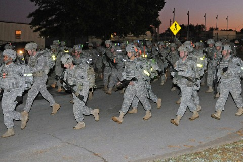 Soldiers from 1st Brigade Combat Team, 101st Airborne Division, set off on their 20 km ruck march as one of the final events for the Fire Support Team Certification Oct. 21st outside the brigade headquarters. (Photo by Sgt. Jon Heinrich)