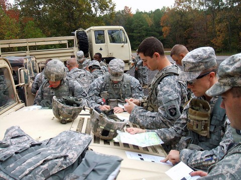 Soldiers from 1st Brigade Combat Team, 101st Airborne Division, mark points on the maps during their Fire Support Team Certification Oct. 13th at the land navigation course. (Photo by Sgt. Jon Heinrich)