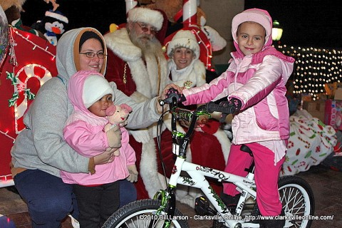 A young girl visiting with Santa Claus at Christmas on the Cumberland 2010.