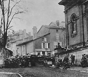 Soldiers of the 353rd Infantry near a church at Stenay, Meuse in France, wait for the end of hostilities.  This photo was taken at 10:58am, on November 11th, 1918, two minutes before the armistice ending World War I went into effect.
