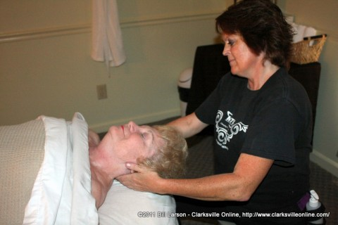Tina Ellis works on Sue Culverhouse's neck during her massage