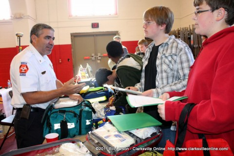 A representative from the Montgomery County EMS speaks with some middle school students