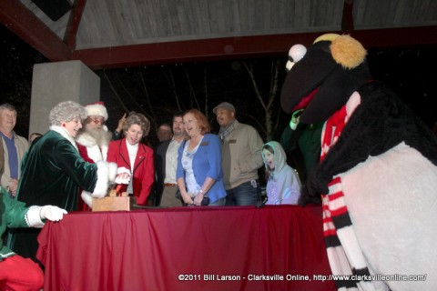 Clarksville Mayor Kim McMillan kicks off the 2011 Christmas on the Cumberland with the assistance of Santa and Mrs. Claus