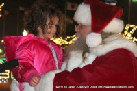Santa Claus talks with a young lady about her Christmas wishes at the kickoff for the 2011 Christmas at the Cumberland