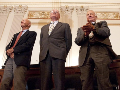 Apollo 11 astronauts, from left, Michael Collins, Neil Armstrong and Buzz Aldrin stand in recognition of astronaut John Glenn during the U.S House of Representatives Committee on Science and Technology tribute to the Apollo 11 astronauts at the Cannon House Office Building on Capitol Hill, Tuesday, July 21st, 2009, in Washington. (Image Credit: NASA/Bill Ingalls)
