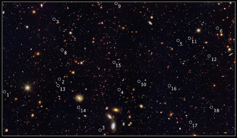 This image reveals 18 tiny galaxies uncovered by NASA's Hubble Space Telescope. The puny galaxies, shown in the postage stamp-sized images, existed 9 billion years ago and are brimming with star birth. Hubble's Wide Field Camera 3 and Advanced Camera for Surveys spied the galaxies in a field called the Great Observatories Origins Deep Survey (GOODS). (Credit: NASA, ESA, A. van der Wel (Max Planck Institute for Astronomy, Heidelberg, Germany), H. Ferguson and A. Koekemoer (STScI.), and the CANDELS team)