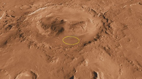 This oblique, southward-looking view of Gale crater shows the landing site and the mound of layered rocks that NASA's Mars Science Laboratory will investigate. The landing site is in the smooth area in front of the mound (marked by a yellow ellipse, which is 12.4 miles (20 kilometers) by 15.5 miles (25 kilometers)). (Credit: NASA)