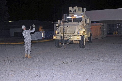 Second Battalion, 327th Infantry Regiment, 1st Brigade Combat Team, 101st Airborne Division, assists in backing up a Mine-Resistant Ambush Protected vehicle Nov. 17th, outside their battalion here. (Photo by Sgt. Richard Daniels Jr.)