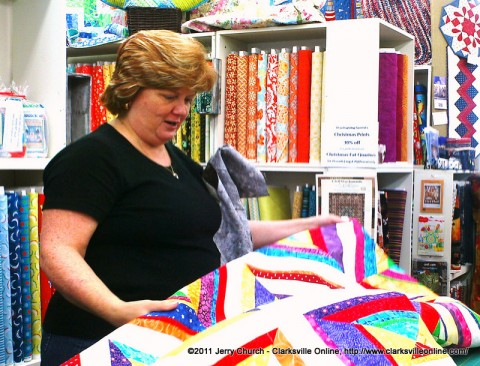 A customer at the Quilt and Sew at Golden Threads looking at a quilt