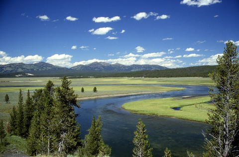 In Yellowstone, the rim of a supervolcano caldera is visible in the distance. (Credit: National Park Service.)